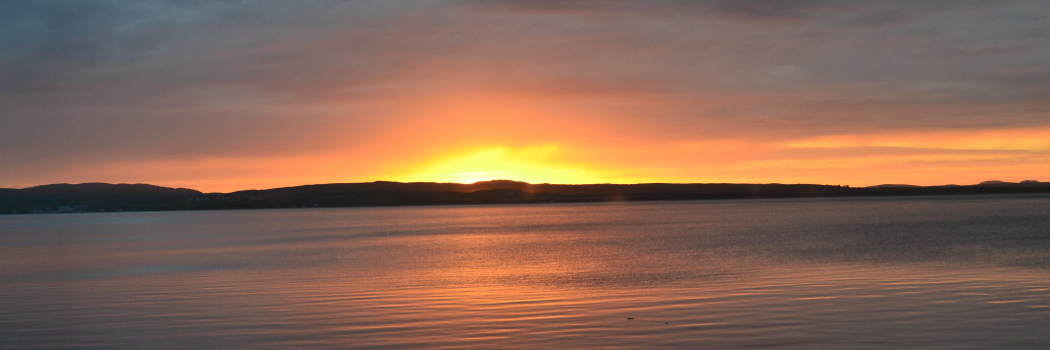Sunset across Loch Indaal from the living room